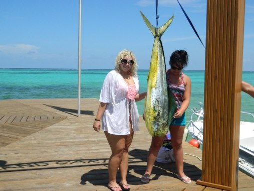 posing with a big fish on grand caribe dock north ambergris caye