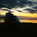 A picture of the Astrum helicopter with the beautiful sunset in the background.